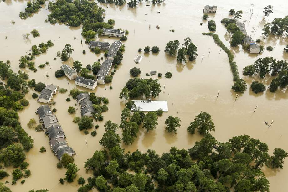 Floodwaters from the San Jacinto River inundate condominiums in the aftermath of Tropical Storm Harvey on Wednesday, Aug. 30, 2017, in Kingwood. ( Brett Coomer / Houston Chronicle ) Photo: Brett Coomer/Houston Chronicle