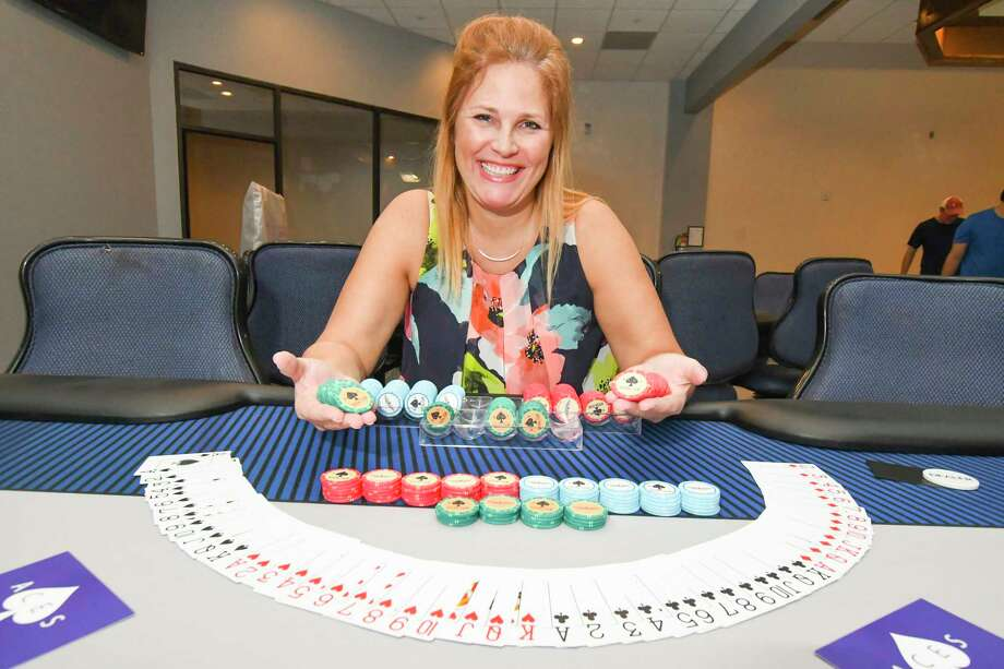 "Aces Social Club recently opened and is offering Omaha and Texas Hold 'Em style poker tournaments. Membership director Tricia Helford said card games such as Omaha Hold 'Em and Texas Hold 'Em are games of skill and not luck. ""There's more reading the player than there is in luck,"" Helford said. ""More of the pots in these games are won prior to the last card being dealt."" Photo: Tony Gaines, Photographer"