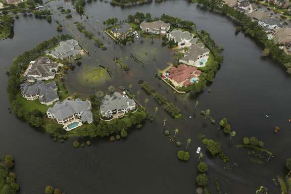 Floodwaters fill the road running through the Lakes On Eldridge North subdivision in the aftermath of Tropical Storm Harvey on Wednesday, Aug. 30, 2017, in Houston. ( Brett Coomer / Houston Chronicle )