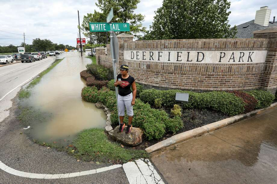 Tiffany Carroll waits anxiously by the entrance to her neighborhood, where water from the Addicks Reservoir has risen quickly, Wednesday, Aug. 30, 2017, in Houston. ( Jon Shapley  / Houston Chronicle ) Photo: Jon Shapley/Houston Chronicle