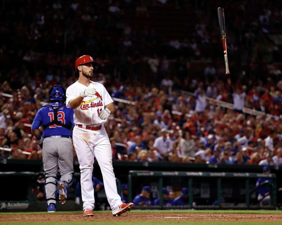 St. Louis Cardinals' Paul DeJong tosses his bat as Chicago Cubs catcher Alex Avila jogs off the field after DeJong struck out to end the eighth inning of a baseball game Thursday, Sept. 28, 2017, in St. Louis. (AP Photo/Jeff Roberson) Photo: Jeff Roberson, STF / Copyright 2017 The Associated Press. All rights reserved.