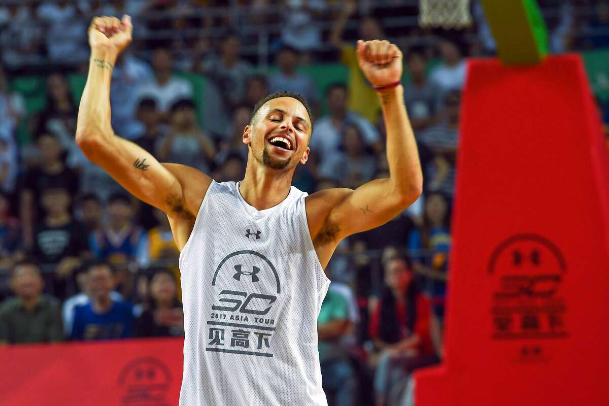 CHENGDU, CHINA - JULY 24: NBA star Stephen Curry of Golden State Warriors meets fans at University of Electronic Science and Technology of China on July 24, 2017 in Chengdu, China. (Photo by VCG/VCG via Getty Images)