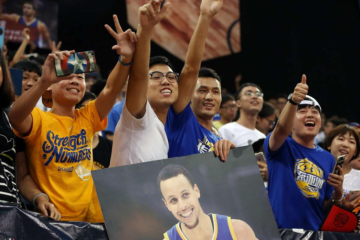 GUANGZHOU, CHINA - SEPTEMBER 03: Fans cheer for American professional basketball NBA player Stephen Curry of the Golden State Warriors who attends a commercial event for Under Armour at Asian Games Stadium on September 3, 2016 in Guangzhou, China. (Photo by Zhong Zhi/Getty Images)