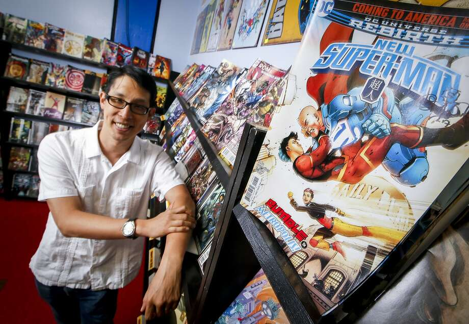 "Gene Luen Yang, at Illusive Comics bookstore in Santa Clara, was a high school teacher who printed out his graphics-comic books by hand before he achieved critical success and subsequent wide popularity with his ""American Born Chinese"" in 2006. Photo: Tony Avelar, Special To The Chronicle"