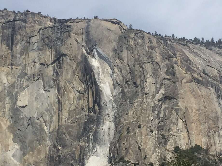 A massive new rock fall hit Yosemite National Park on Thursday, cracking with a thundering roar off the iconic El Capitan rock formation and sending huge plumes of white dust surging through the valley floor below. Photo: Courtesy Of Terry Fernsworth