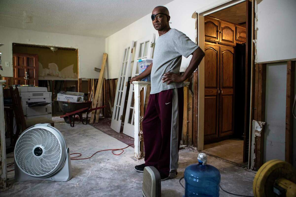 Eugene Cox stands in his Arbor Oaks neighborhood home on Wednesday, Sept. 20, 2017, after it was flooded in the aftermath of Hurricane Harvey. It was the first time his house, which sits on higher ground in the neighborhood, flooded.
