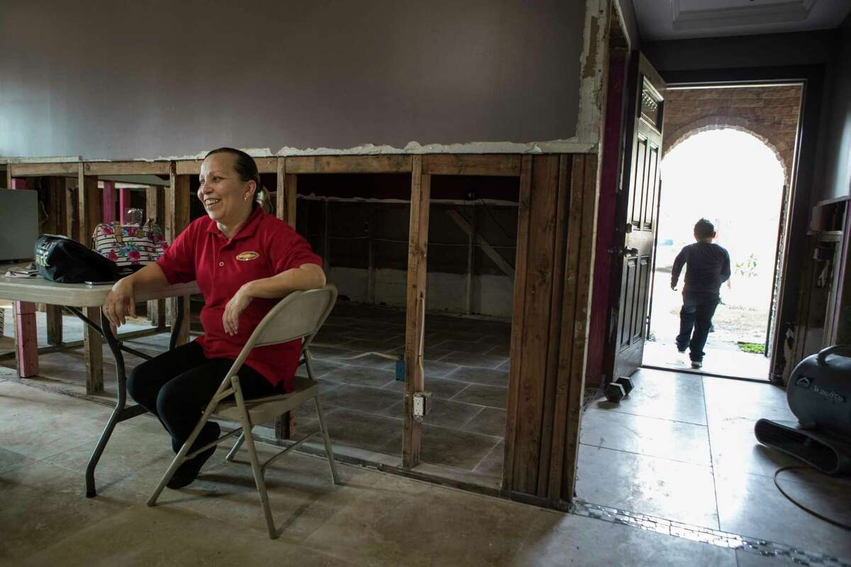 Rosa Mendoza sits on folding chair in her home, which was flooded in the aftermath of Hurricane Harvey, in the Arbor Oaks neighborhood on Wednesday, Sept. 20, 2017, in Houston..