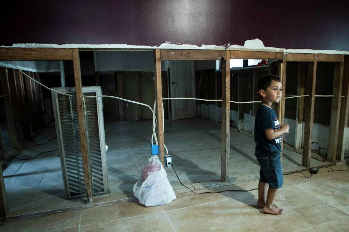 Anthony Civallero, 3, stands in his grandmother's home, which was flooded in the aftermath of Hurricane Harvey, in the Arbor Oaks neighborhood on Wednesday, Sept. 20, 2017, in Houston. The neighborhood used to be home to 160 houses and is now down to 13, after most of the homeowners, having flooded repeatedly, sold to the county Flood Control District.