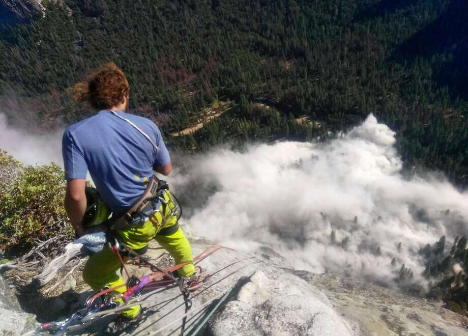 In this photo provided by Peter Zabrok, climber Ryan Sheridan who had just reached the top of El Capitan, a 7,569-foot (2,307 meter) formation, when a rock slide let loose below him Thursday, Sept. 28, 2017, in Yosemite National Park, Calif. It was not immediately clear if there were new casualties, a day after another slab dropped from El Capitan, killing a British climber and injuring a second. (Peter Zabrok via AP) Photo: Peter Zabrok, Associated Press