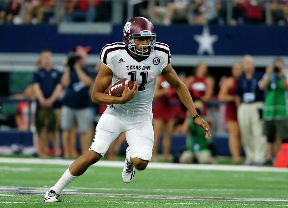 Texas A&M quarterback Kellen Mond (11) scrambles for yardage against Arkansas during an NCAA college football game, Saturday, Sept. 23, 2017, in Arlington, Texas. (AP Photo/Tony Gutierrez) Photo: Tony Gutierrez, STF / Copyright 2017 The Associated Press. All rights reserved.