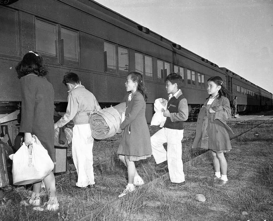 September 1942: California children from Japanese families who had been forcibly displaced from their homes board a train from Tanforan internment camp in San Bruno to another camp in Utah. Photo: Chronicle File Photo 1942