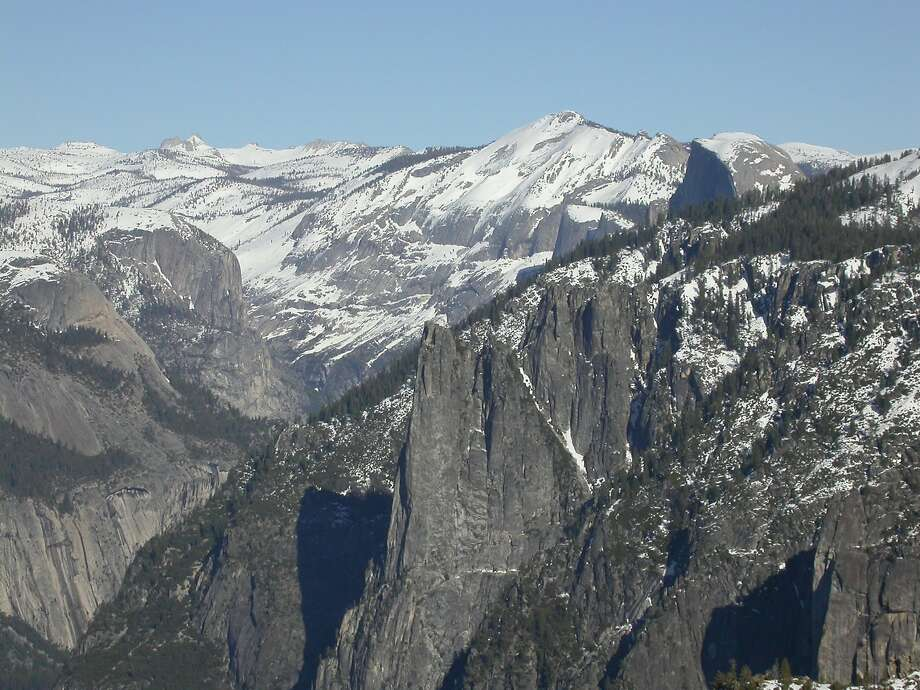 View from 7,385-foot Dewey Point on Yosemite's South Rim. You can see Cathedral Spire (center) and beyond to Half Dome (upper right) and Clark and Cathedral ranges. On Friday a woman climbing Cathedral Spire was injured when she fell 30 feet and had to be rescued by helicopter. Photo: Tom Stienstra