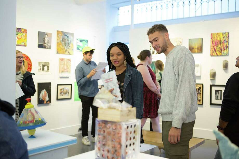 Visitors peruse the offerings of Artspace's City-Wide Open Studios in New Haven at last year's opening reception. Photo: Judy Sirota Rosenthal / Artspace / Contributed Photo / © 2016 sirota rosenthal