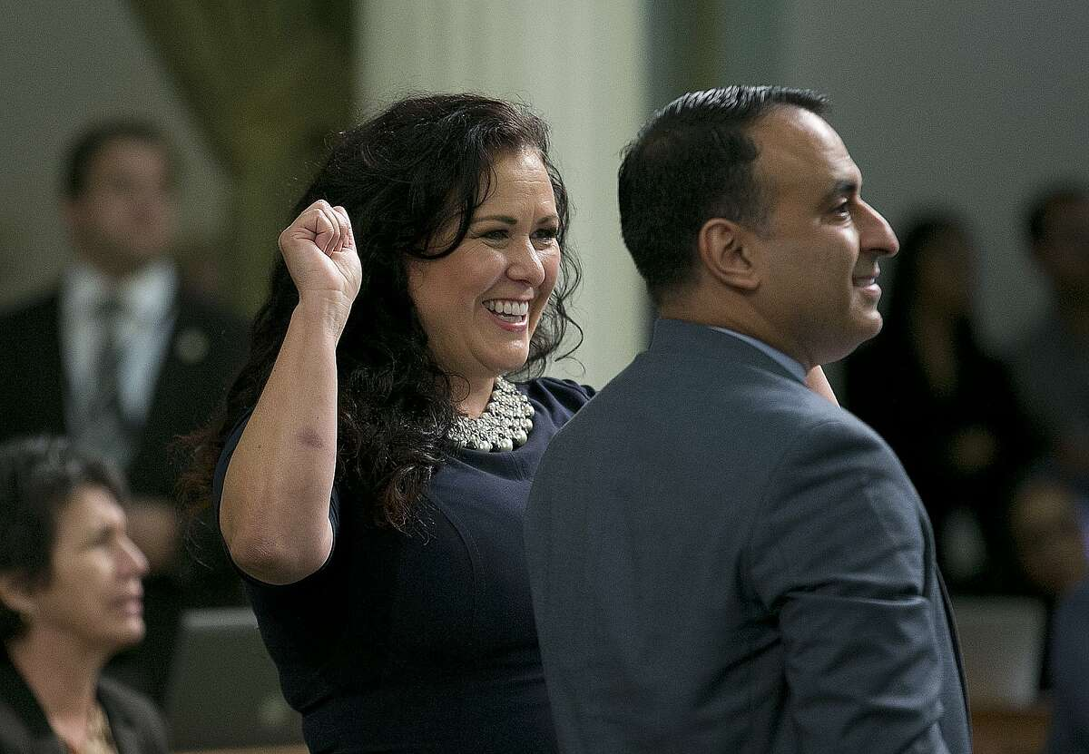 Assemblywoman Lorena Gonzalez Fletcher, D-San Diego, flanked by Assemblyman Ash Kalra, D-San Jose, celebrates as the