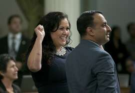 """Assemblywoman Lorena Gonzalez Fletcher, D-San Diego, flanked by Assemblyman Ash Kalra, D-San Jose, celebrates as the """"sanctuary state"""" bill she carried in the Assembly was approved, Friday, Sept. 15, 2017, in Sacramento, Calif. The bill, SB54, by Senate President Pro Tem Kevin de Leon, D-Los Angeles, would limit police cooperation with federal immigration authorities, now goes to the Senate for final approval.(AP Photo/Rich Pedroncelli)"""