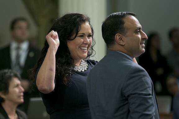 "Assemblywoman Lorena Gonzalez Fletcher, D-San Diego, flanked by Assemblyman Ash Kalra, D-San Jose, celebrates as the ""sanctuary state"" bill she carried in the Assembly was approved, Friday, Sept. 15, 2017, in Sacramento, Calif. The bill, SB54, by Senate President Pro Tem Kevin de Leon, D-Los Angeles, would limit police cooperation with federal immigration authorities, now goes to the Senate for final approval.(AP Photo/Rich Pedroncelli)"