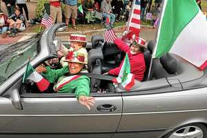 The Greater New Haven Columbus Day Parade rotates among six communities. In 2013 it was in Branford, where participants included Lucille Lamberti (driver), Frances Calcetta (passenger) and Jane Malinconico (back seat).