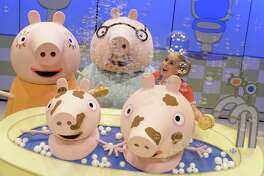 """The touring stage production of """"Peppa Pig's Surprise,"""" comes to the Oakdale Theatre in Wallingford on Sunday, Oct. 8. Above are Mummy Pig and Daddy Pig, played by Evan Michael Pinsonnault, and siblings George and Peppa Pig in the bathtub."""