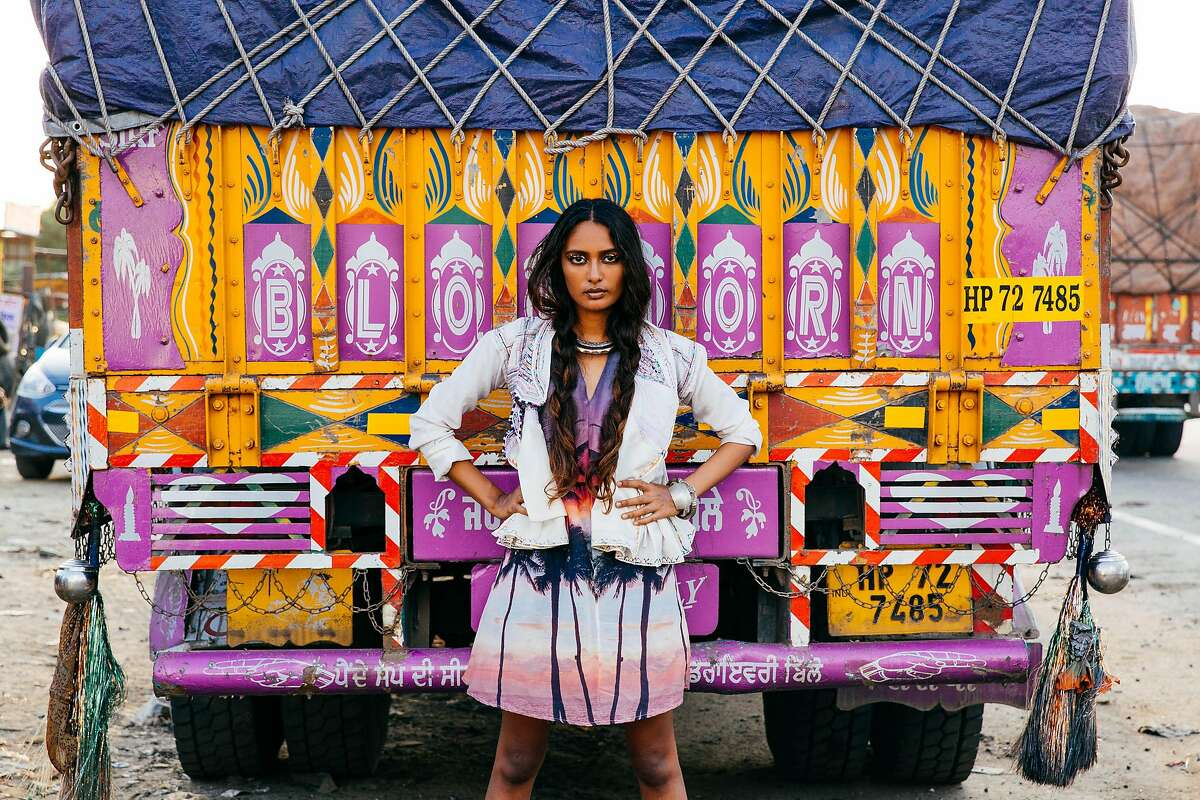 Jennifer Binney created the lookbook for Surf Jaipur, starring a beautiful, long-limbed Indian surfer named Ishita Malaviya. She opted for humble backdrops in Jaipur, India's Old City : A truck stop, where Malaviya wears the Wailea kaftan in front of an ornately painted lorry; or at the flower market, where she poses with the Cotton Candy rope tote; or at the city�s best chai walla, where she sips tea wearing the Point Break design.