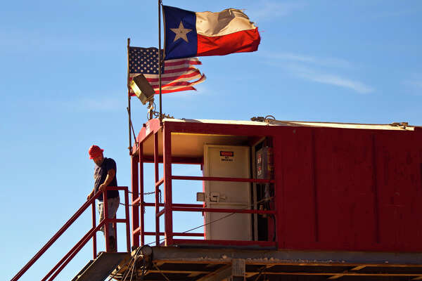 Jerry Moore, driller onboard Robinson Drilling rig #4, stands outside the control room of the rig Wednesday, Feb. 17, 2016, in Midland County. James Durbin/Reporter-Telegram