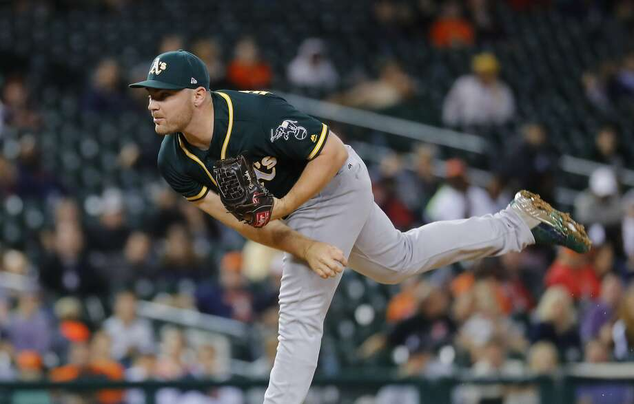 Oakland Athletics relief pitcher Liam Hendriks throws against the Detroit Tigers in the fifth inning of a baseball game in Detroit, Monday, Sept. 18, 2017. (AP Photo/Paul Sancya) Photo: Paul Sancya, Associated Press