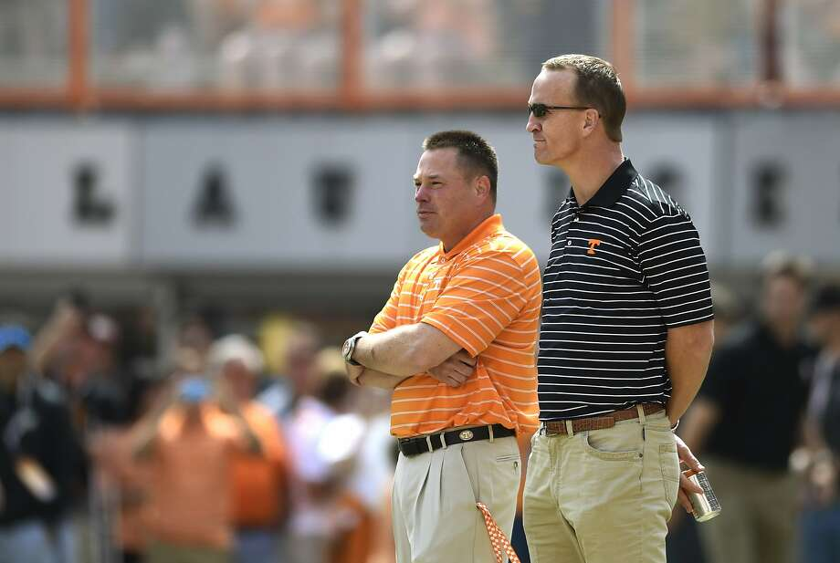 Tennessee coach Butch Jones (left) and Peyton Manning in 2015. Photo: ADAM LAU, Associated Press