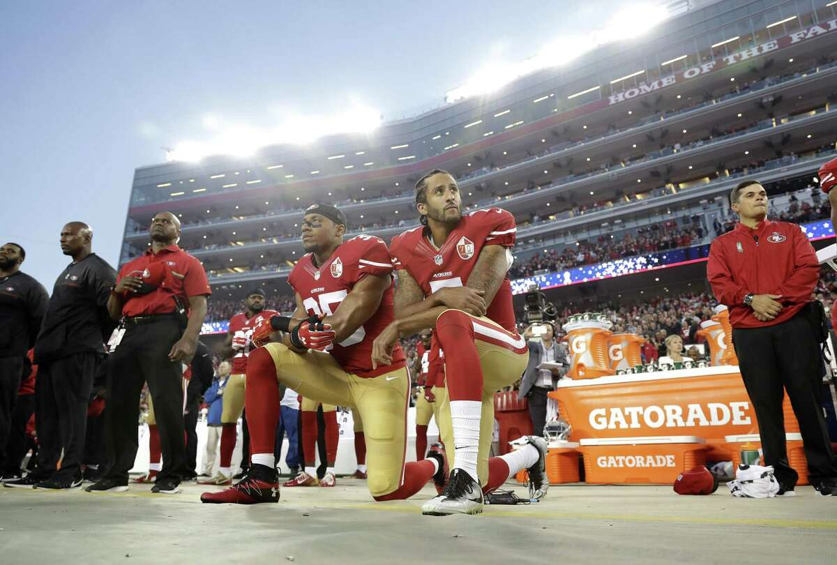 San Francisco 49ers safety Eric Reid and quarterback Colin Kaepernick kneel during the national anthem before an NFL football game Sept. 12, 2016. What began more than a year ago with a lone NFL quarterback protesting police brutality against minorities by kneeling silently during the national anthem before games has grown into a roar with hundreds of players sitting, kneeling, locking arms or remaining in locker rooms, their reasons for demonstrating as varied as their methods.