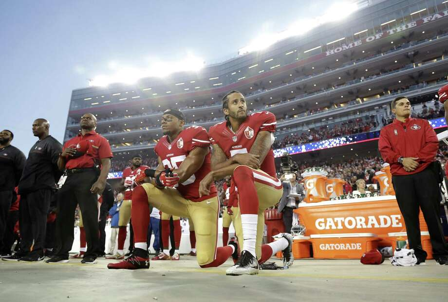 San Francisco 49ers safety Eric Reid and quarterback Colin Kaepernick kneel during the national anthem before an NFL football game Sept. 12, 2016. What began more than a year ago with a lone NFL quarterback protesting police brutality against minorities by kneeling silently during the national anthem before games has grown into a roar with hundreds of players sitting, kneeling, locking arms or remaining in locker rooms, their reasons for demonstrating as varied as their methods. Photo: Marcio Jose Sanchez /Associated Press / Copyright 2017 The Associated Press. All rights reserved.