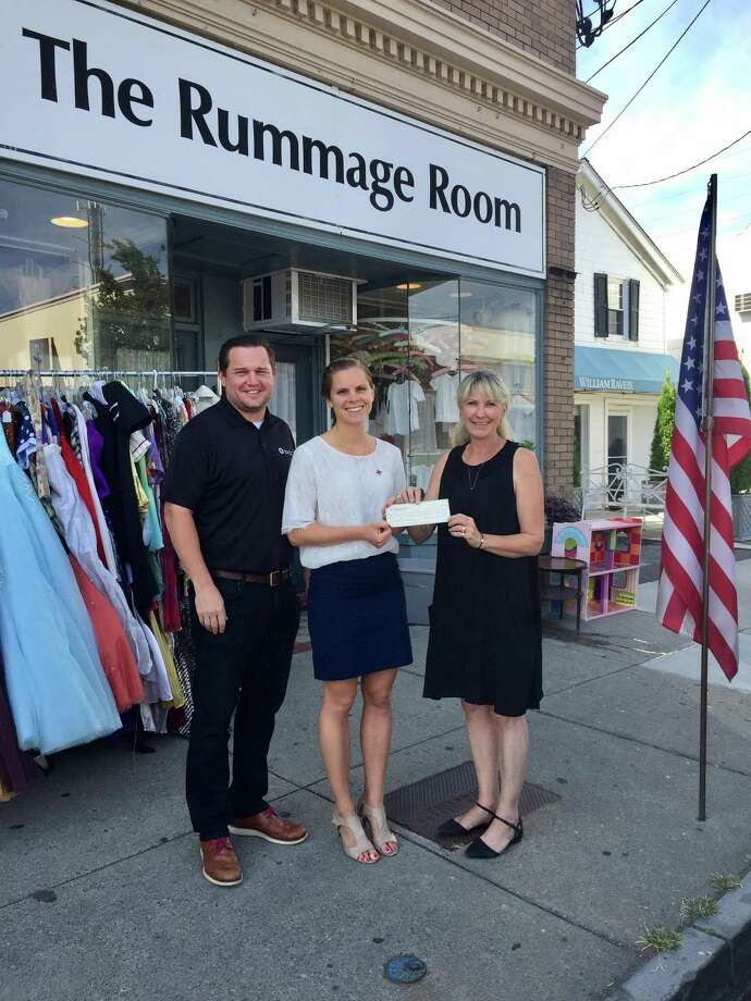 Leanne Meyer, (right) manager of the Rummage Room in Old Greenwich, CT proudly presents a check of $4,824 to the American Red Cross Harvey Relief Fund to Amanda Paktinat and Brandon Ponder, development team of the Metro New York North American Red Cross. Photo: Contributed