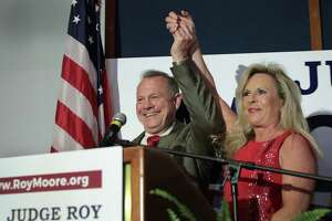 Republican candidate for the U.S. Senate in Alabama, Roy Moore and his wife Kayla greet supporters at an election-night rally on Tuesday in Montgomery, Alabama. Moore, former chief justice of the Alabama supreme court, defeated incumbent Luther Strange in a primary runoff election for the seat vacated when Jeff Sessions was appointed U.S. Attorney General by President Donald Trump.