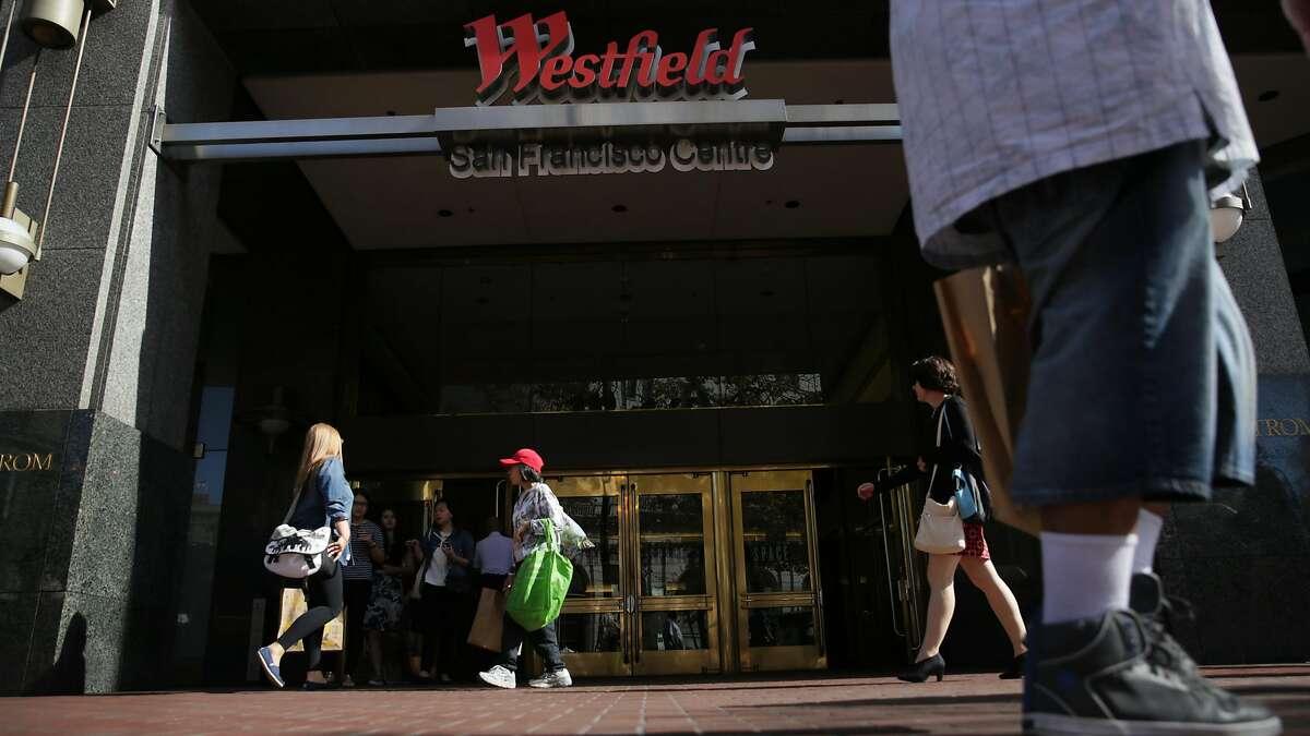 Pedestrians on Market Street walk past an entrance to Westfield San Francisco Centre on Friday, September 25, 2015 in San Francisco, Calif.