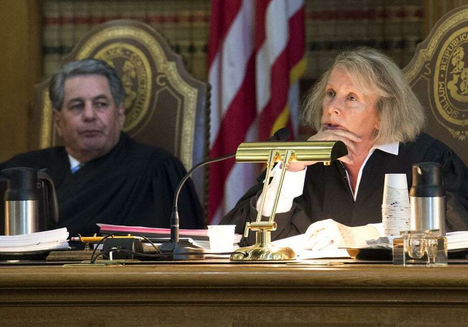 Chief Justice Chase T. Rogers, right, and Justice Richard N. Palmer, left, listen to opening statements at Connecticut's state Supreme Court, Thursday, Sept. 28, 2017, in Hartford, Conn. Justices heard arguments in the state's appeal of a landmark ruling that declared Connecticut's system for funding public schools unconstitutional. (Patrick Raycraft/The Courant via AP) Photo: Patrick Raycraft / Associated Press / The Courant