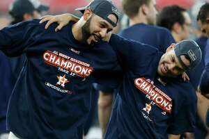 Jose Altuve (27) and Marwin Gonzalez (9), celebrating after clinching the American League West two weeks ago, have seen the highs and lows of Astros in their Houston careers. ( Karen Warren / Houston Chronicle )