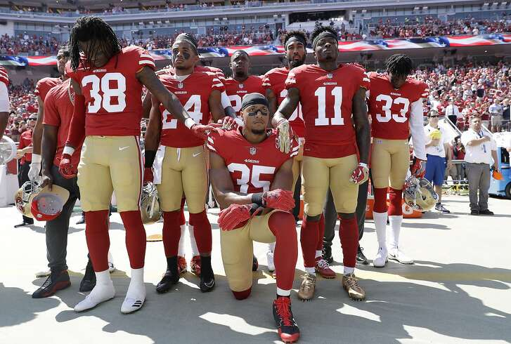 FILE - In this Sept. 10, 2017, file photo, San Francisco 49ers safety Eric Reid (35) kneels in front of teammates during the national anthem before an NFL football game against the Carolina Panthers in Santa Clara, Calif., Sunday. Reid was an early protester during the national anthem, joining former San Francisco teammate Colin Kaepernick last season.  (AP Photo/Marcio Jose Sanchez, File)
