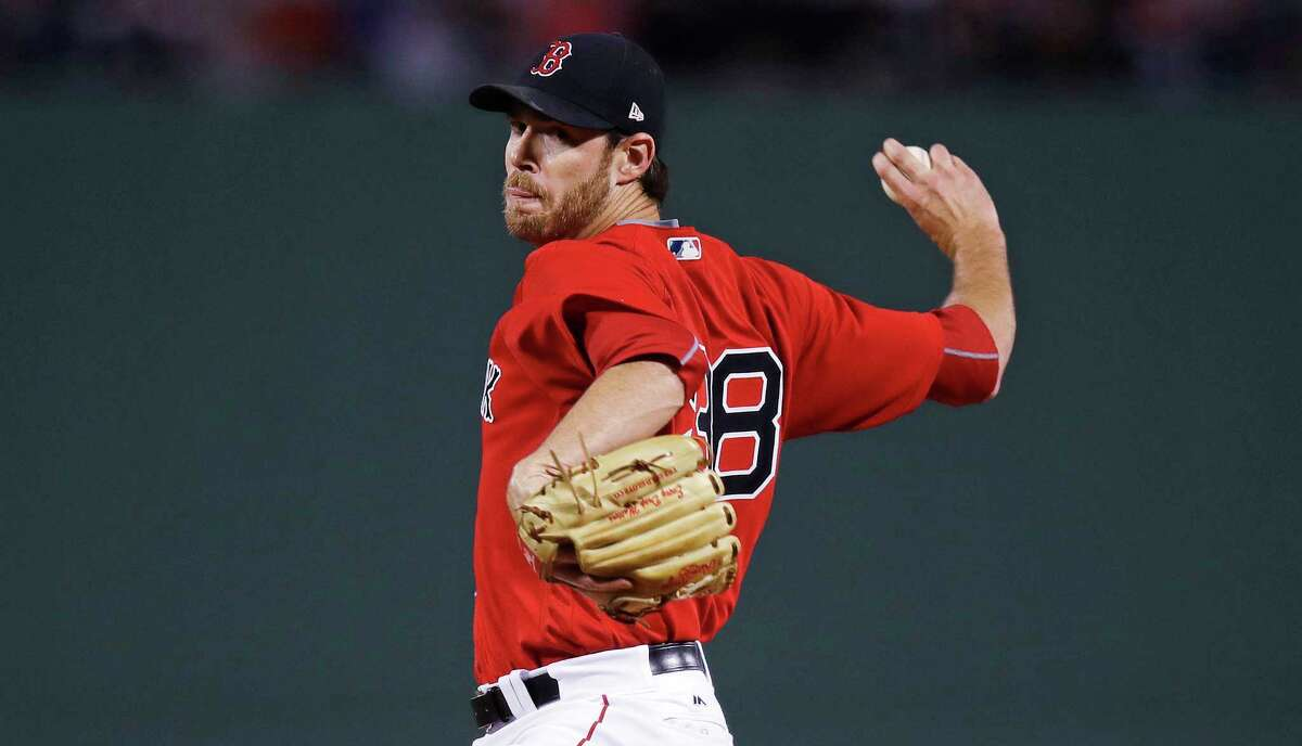 Boston Red Sox starting pitcher Doug Fister winds up during the first inning of a baseball game against the Houston Astros at Fenway Park in Boston, Friday, Sept. 29, 2017. (AP Photo/Charles Krupa)