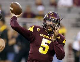 Arizona State quarterback Manny Wilkins warms up for an NCAA college football game against Oregon, Saturday, Sept. 23, 2017, in Tempe, Ariz. (AP Photo/Rick Scuteri)