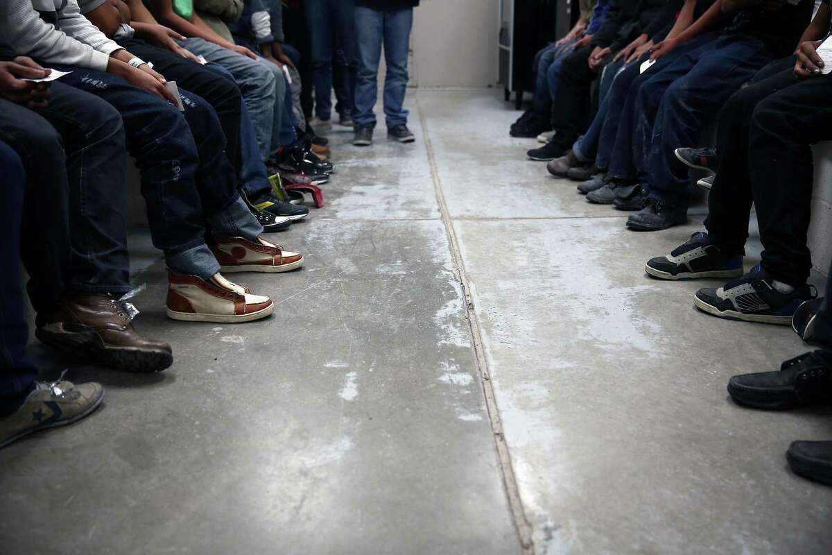 Immigrants caught trying to cross the border are detained in McAllen. The number of people trying to cross the U.S. border with Mexico plummeted significantly after Trump took office. Sarah Rodriguez, a spokeswoman for ICE, acknowledged that the record decline in apprehensions at the border had an impact on the overall number of deportations.