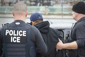 Foreign nationals are arrested during a targeted enforcement operation conducted by U.S. Immigration and Customs Enforcement earlier this year. A 12 percent drop in deportations has occurred even as the number of migrants ICE agents have arrested since Trump took office in January jumped by 43 percent to some 97,500 compared to the same time frame in 2016.