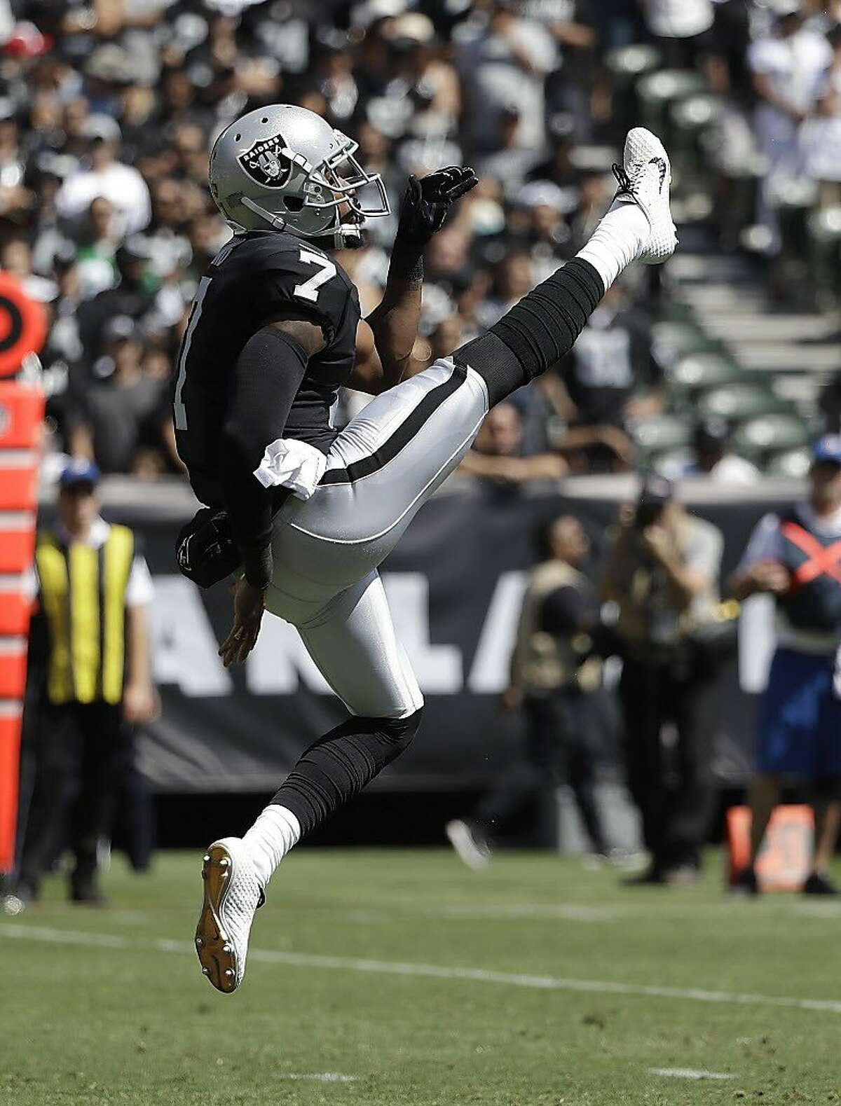 Oakland Raiders punter Marquette King (7) against the New York Jets during an NFL football game in Oakland, Calif., Sunday, Sept. 17, 2017. (AP Photo/Marcio Jose Sanchez)