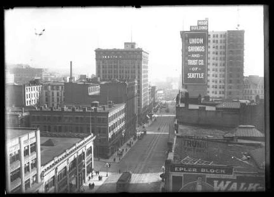 View south on Second Avenue from Columbia Street, downtown Seattle, circa 1910. In view are Seattle Trunk Factory, Hoge Building, Union Savings and Trust. Photo: Courtesy Seattle Public Library