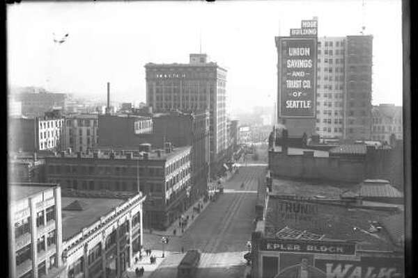 View south on Second Avenue from Columbia Street, downtown Seattle, circa 1910. In view are Seattle Trunk Factory, Hoge Building, Union Savings and Trust.