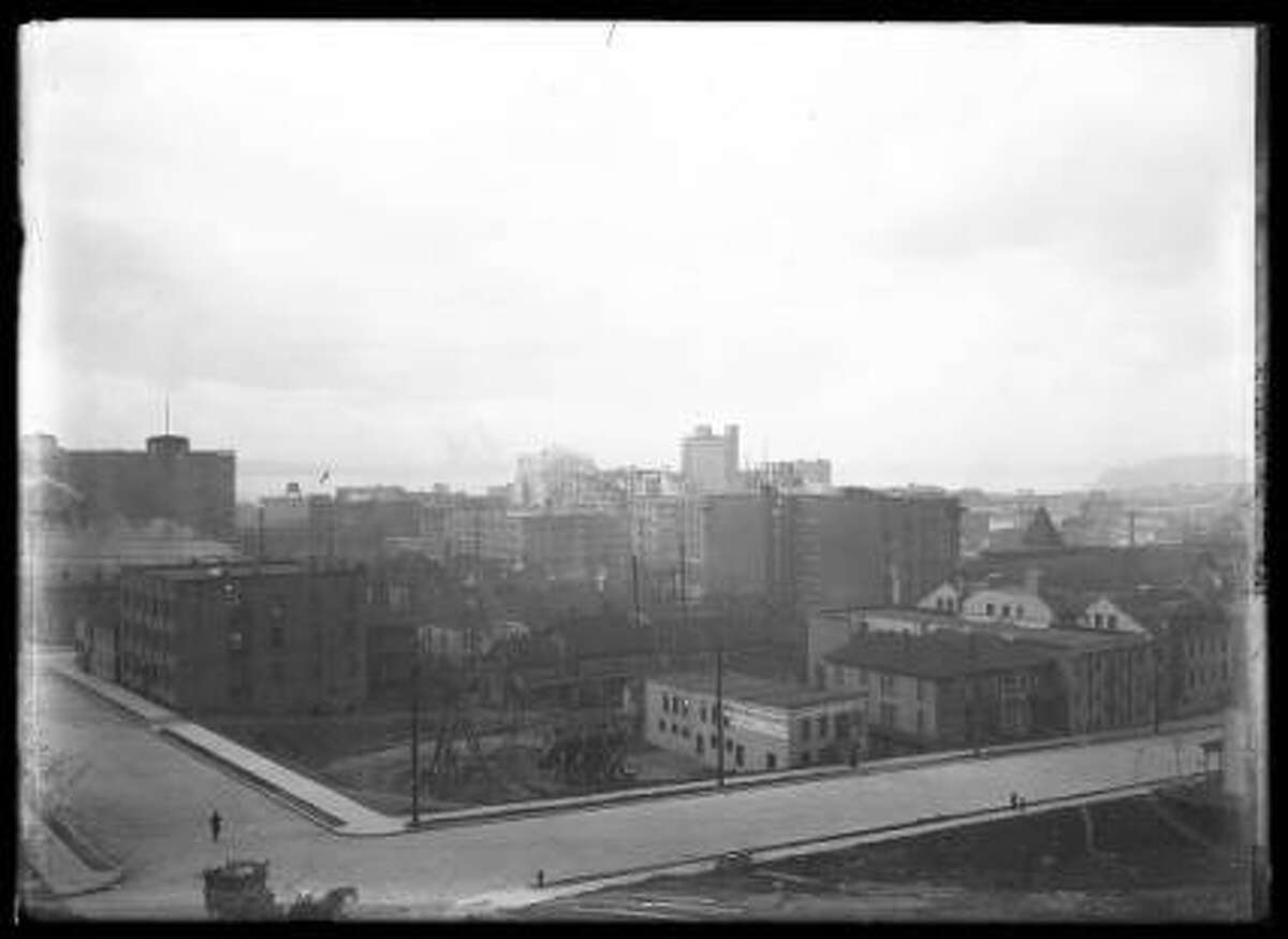 This view west from Eighth Avenue and University Street shows part of downtown Seattle in roughly 1910.