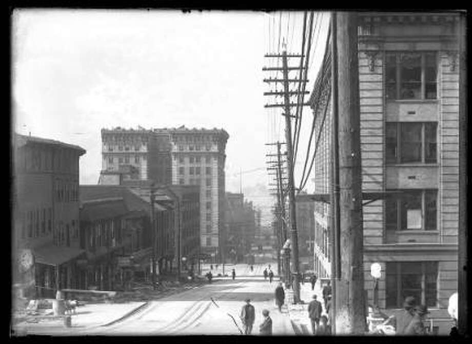 View west from Yesler Way and Fourth Ave., ca. 1911, downtown Seattle. -SPL Photo: Courtesy Seattle Public Library