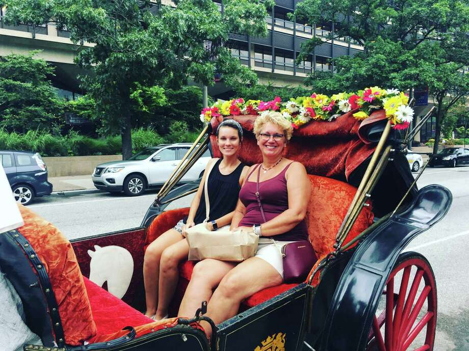 Kelly Bemmes, left, and her mom, Kimberly Bemmes, enjoy a horse and carriage ride during a surprise vacation in Philadelphia. Photo: Kelly Bemmes. / Kelly Bemmes