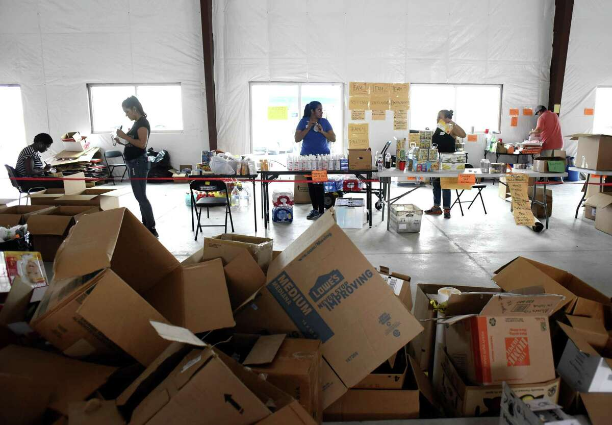 People in a San Antonio warehouse sort and pack items collected to be sent to the people of Puerto Rico struggling in the aftermath of Hurricane Maria.