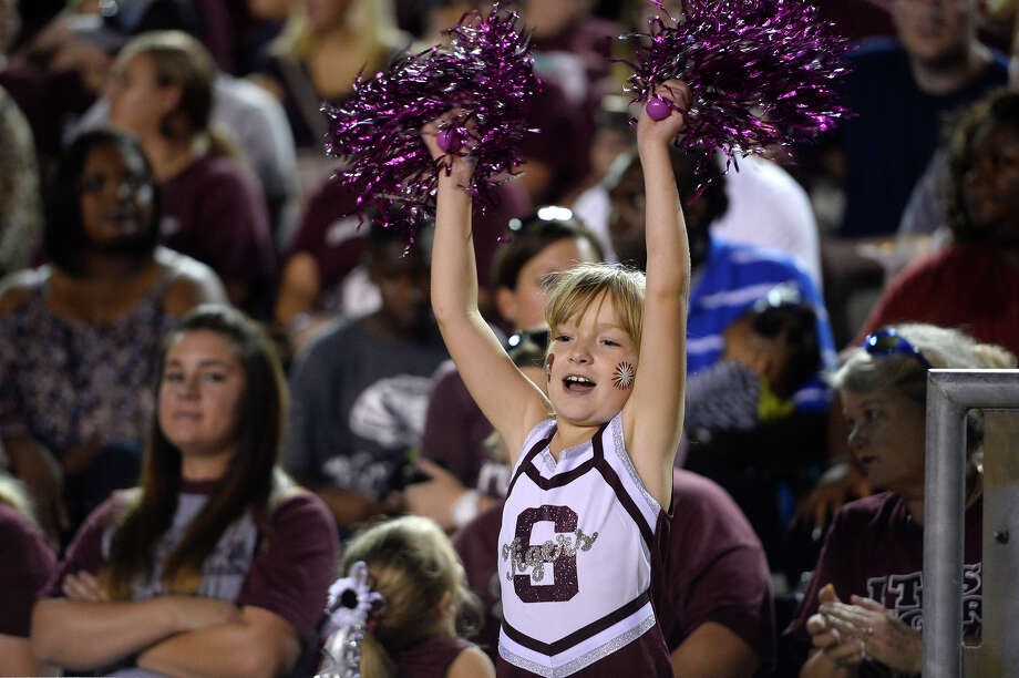 Isabella Moreno, 8, cheers on the Silsbee Tigers as they play West Orange-Stark at Tiger Stadium on Friday.  Photo taken Friday 9/29/17 Ryan Pelham/The Enterprise Photo: Ryan Pelham / ©2017 The Beaumont Enterprise/Ryan Pelham