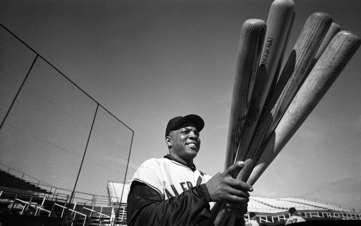 1962: San Francisco Giants player Willie Mays looking at his bats during spring training on February 23, 1962. (Photo by Rogers Photo Archive/Getty Images)