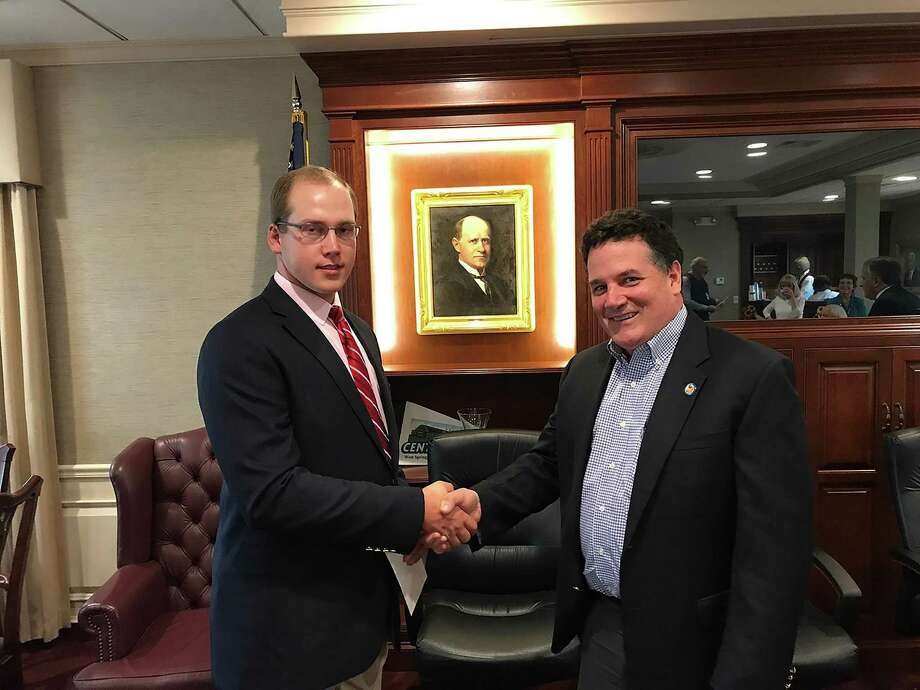 Matthew Sniffen of Litchfield, left, Connecticut Corporators of Eastern States Exposition (ESE) Undergraduate Scholarship Recipient 2017-2018, is congratulated by ESE board member Jim Lyman. Photo: Contributed Photo / Not For Resale