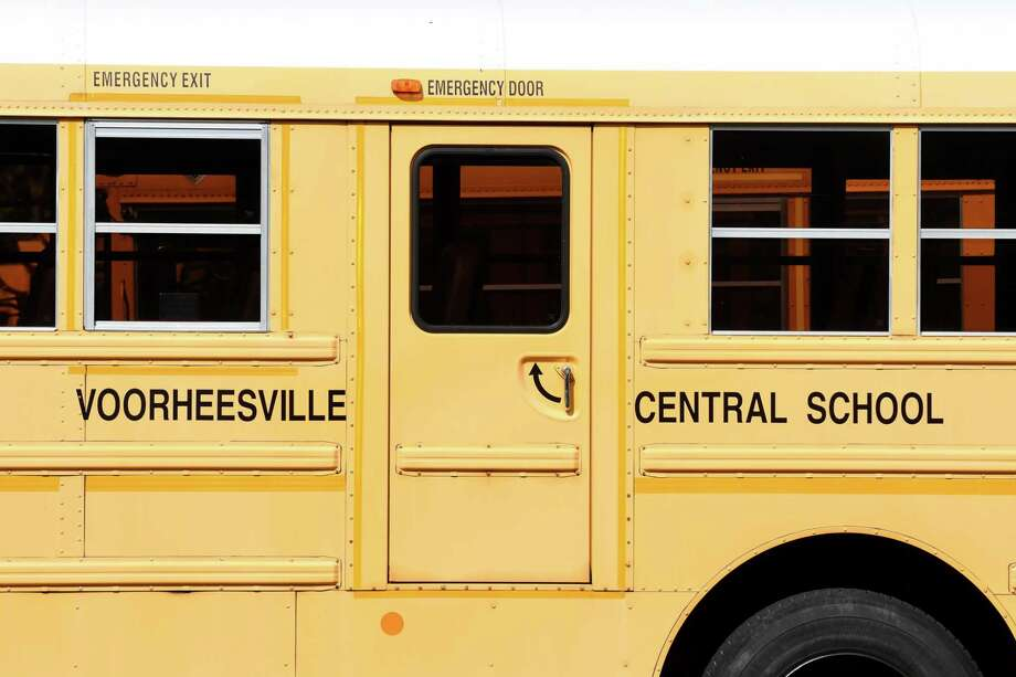 A Voorheesville Central School District bus is parked outside the elementary school on Thursday, Sept. 28, 2017, in Voorheesville, N.Y. (Will Waldron/Times Union) Photo: Will Waldron / 20041649A