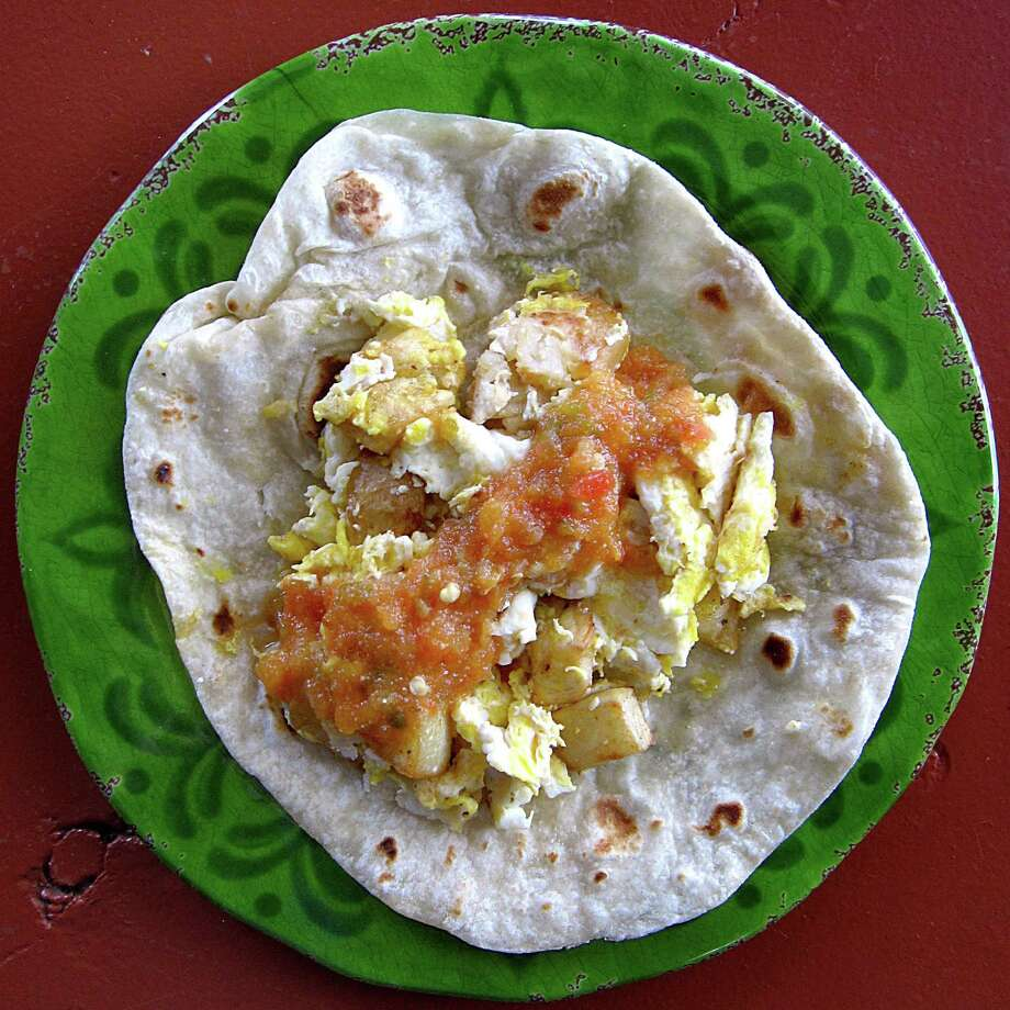 Potato and egg taco with salsa on a handmade flour tortilla from Rosita's Mexican Restaurant. Photo: Mike Sutter /San Antonio Express-News